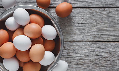 Bowl of fresh brown and white eggs