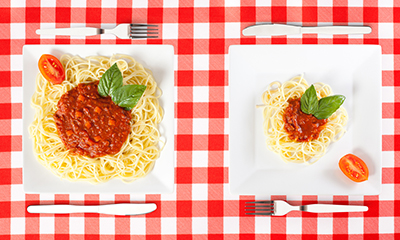 Two different size spaghetti plates