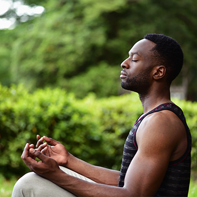 meditating man in garden